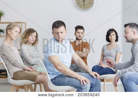 Unhappy Man During Group Therapy