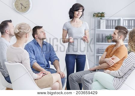 Smiling Woman During Group Conversation
