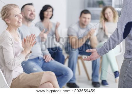 Man Standing In Support Group