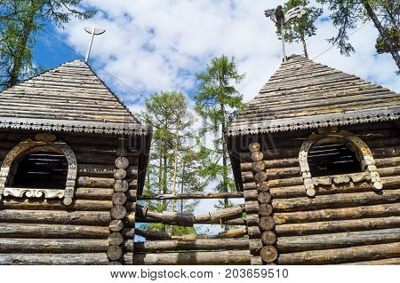 Yakutia. a wooden tower in the forest, a wooden tower in the taiga, a castle made of wood in a coniferous forest.
