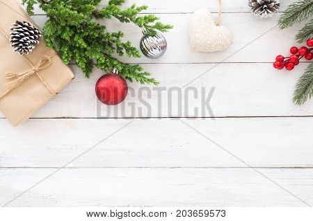 Christmas theme Background. Christmas gift box fir branches and decoration rustic elements on white wooden background. Creative flat lay top view design