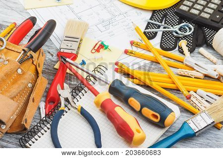 Drawings, Helmet And A Construction Belt With Different Construction Tools