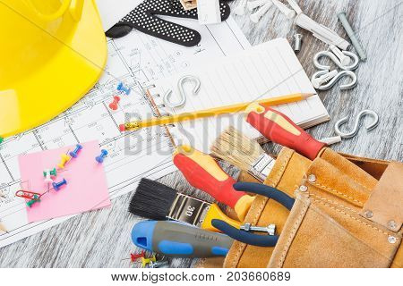 Drawings, Yellow Helmet And A Construction Belt With Different Construction Tools, Soft Focus Backgr