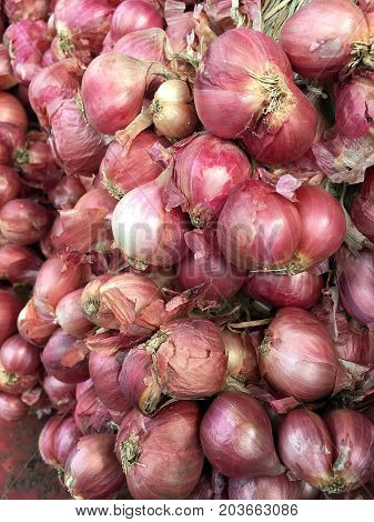 Red Onions In Plenty On Display At Local Farmer's Thailand Market. Big Red Onions Background, Eleuth