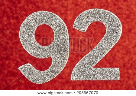 Number ninety-two silver color over a red background. Anniversary. Horizontal