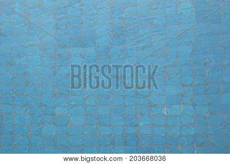 Water in the pool. Blue tile in swimming pool. Detail of pool.