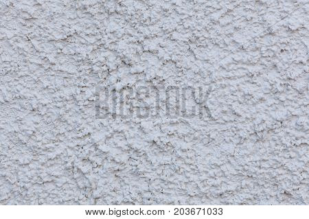 White painted cement wal background pattern extreme closeup