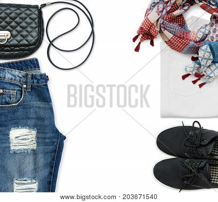White t-shirt blue boyfriend jeans crossbody bag scarf and black textile shoes on white background. Flat lay. Trendy casual outfit.