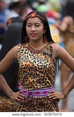 June 17 2017 Pujili Ecuador: indigenous female dancer in leopard skin themed dres at the Corpus Christi annual parade