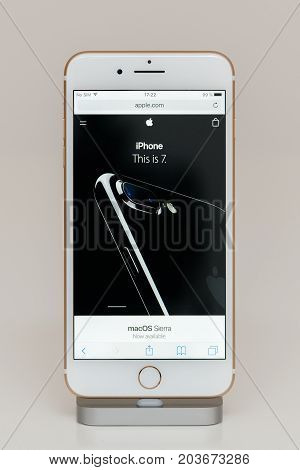 PARIS FRANCE - SEP 26 2016: New Apple iPhone 7 Plus in docking station after unboxing and testing by installing and running the Apple.com website