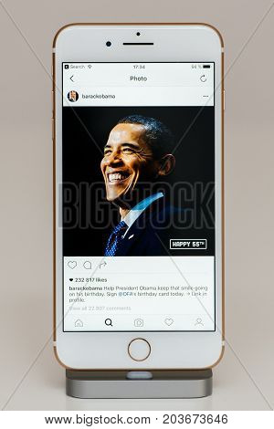 PARIS FRANCE - SEP 26 2016: New Apple iPhone 7 Plus in docking station after unboxing and testing by installing and running the app application software Barack Obama 55th anniversary photos on Instagram official account