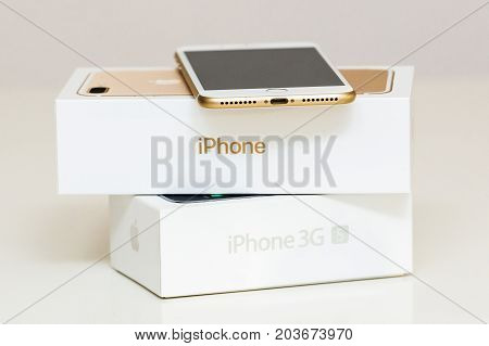 PARIS FRANCE - SEP 26 2016: New Apple iPhone 7 Plus next to old vintage iPhone 3GS box