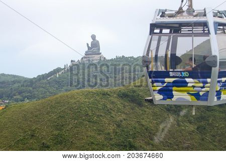 Hong Kong - September 12, 2010 : Ngong Ping 360 cable car carry tourists to top of the hill focus on Big Buddha