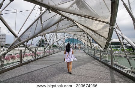 A Tourist On Helix Bridge In Singapore