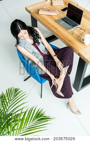 Businesswoman Resting At Workplace
