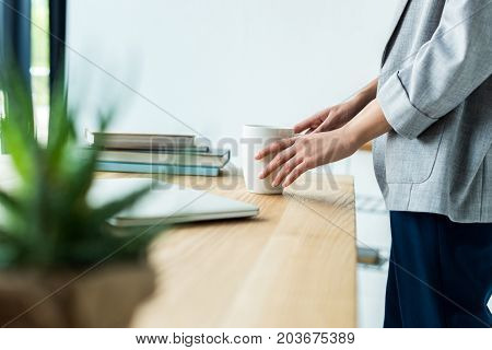 Businesswoman Holding Cup Of Coffee