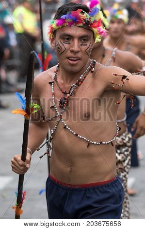 June 17 2017 Pujili Ecuador: indigenous male dancers from the Amazon area at the Corpus Christi annual parade