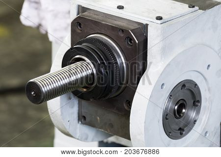 Screw drive of industrial machine. Helical longitudinal transmission.