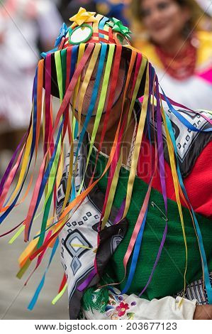 June 17 2017 Pujili Ecuador: traditional colourful kichwa man hat with colorful strings worn at the Corpus Christi annual parade in the Andean town