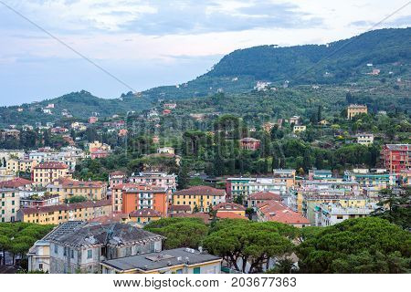Beautiful sunset view to Santa Margherita Ligure city, blue sky and sea in Italy