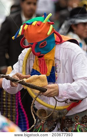 June 17 2017 Pujili Ecuador: colorful traditional indigenous mask worn by male dancer at Corpus Christi parade