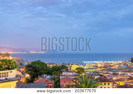 Beautiful night view to Santa Margherita Ligure city and sea in Italy. Flaring lights on background