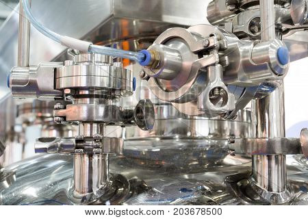 Pharmaceutical equipment, a lot of metal nipples and flanges. Abstract industrial background.