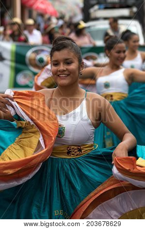 June 17 2017 Pujili Ecuador: indigenous female dancer in colonial style dress at the Corpus Christi annual parade