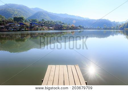Landscape photo of wooden bridge morning with white fog over lake at Ban Rak Thai village, Maehongson or Mae Hong Son Thailand.