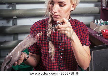 Woman Paints  Horror Hand