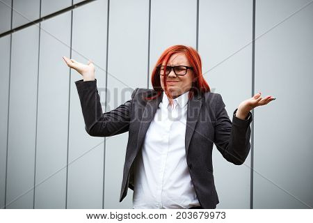 Business Concept Of Success. Serious Successful Woman Boss, In A Suit And Wearing Glasses, Demonstra