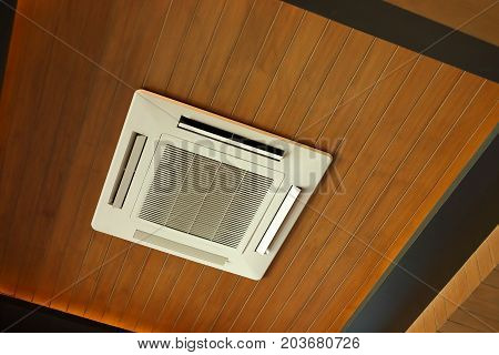 air conditioner cooling cassette type electric equipment on wooden ceiling interior