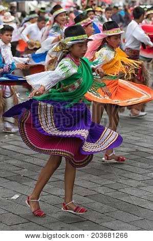 June 17 2017 Pujili Ecuador: female dancers dressed in traditional clothing in motion at the Corpus Christi annual parade