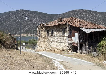 An old, abandoned, collapsed stone house in nom Florina, islet of Saint Achilles (Macedonia, northwest Greece)