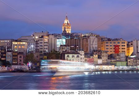 Panoramic cityscape over the Bosphorus with a large residential area and Galata Tower in Istanbul, Turkey
