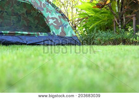 Tent Camping On Green Grass Lawn Campsite, Equipment For Trip Backpack Travel In Nature