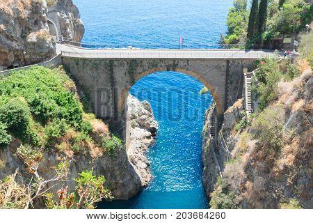 famous picturesque road viaduct over sea of Amalfi coast, Italy