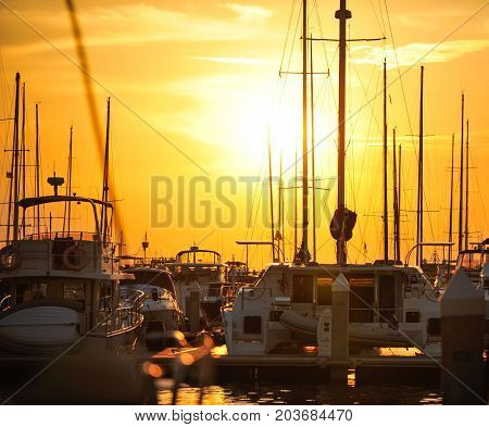 silhouette of yacht marina in sunset time.