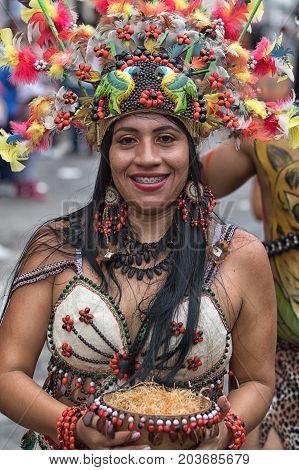 June 17 2017 Pujili Ecuador: female dancer from he Amazon area at the Corpus Christi annual parade