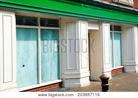 Chester, UK, April 3, 2009 : Bankrupt closed down retail shop with whitewashed windows in the city centre