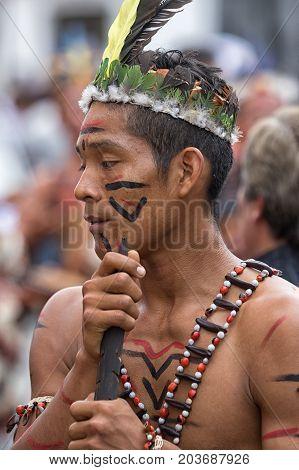 June 17 2017 Pujili Ecuador: closeup of a male dancer from he Amazon area at the Corpus Christi annual parade