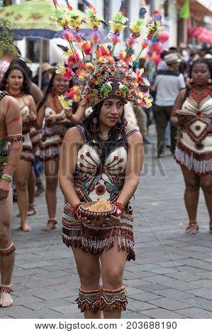 June 17 2017 Pujili Ecuador: female dancer from he Amazon area in traditional region specific costume at the Corpus Christi annual parade