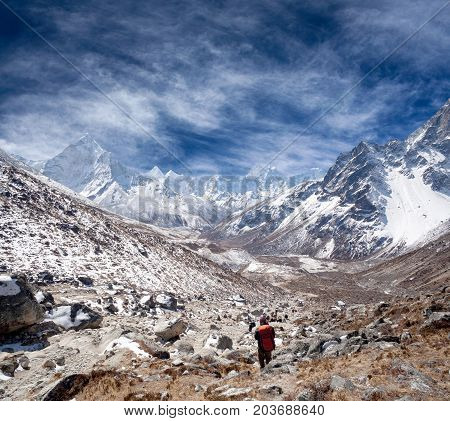 An unidentified hiker on the road to Everest Base camp and Kala Patthar in Sagarmatha National Park, Nepal, Himalayas