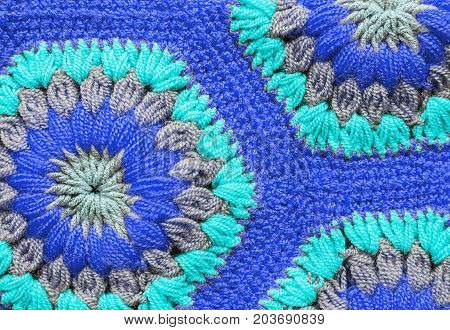 Knitted textile carpet pattern macro in blue color
