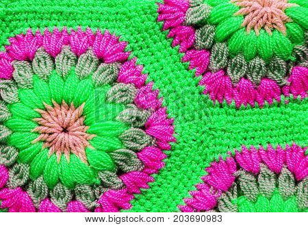 Knitted textile carpet pattern macro in green color