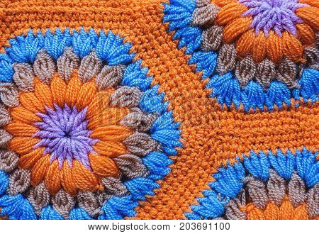 Knitted textile carpet pattern macro in orange color