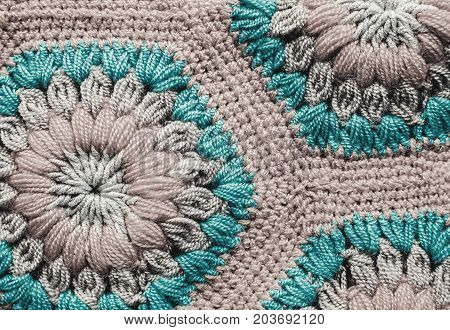 grey and blue Knitted textile carpet pattern macro.
