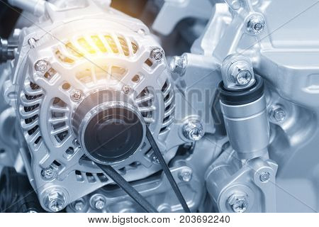 The car alternator in the light blue scene with the lighting effect.Automotive part.