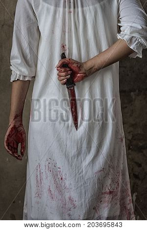 Woman Holding Knife Back On Her Hand With Blood