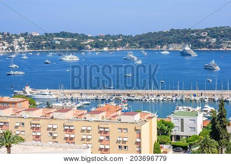 Beautiful daylight view to boats and ships on water in Villefranche-sur-Mer, France.